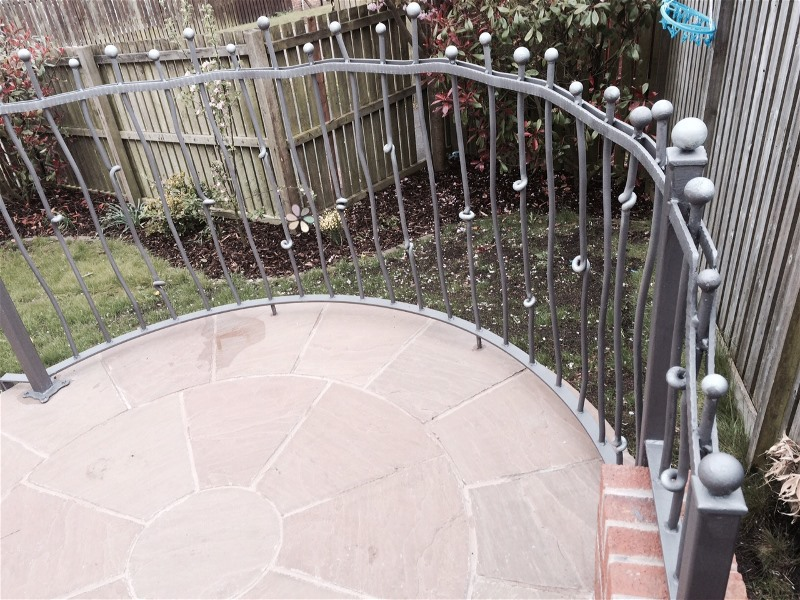 Curved wrought iron railings