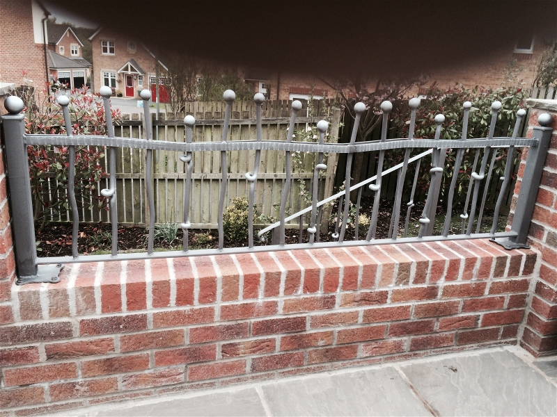 quality wrought iron railings on wall
