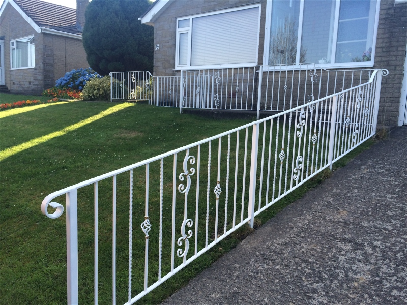 Wrought iron fence ramp railings in white